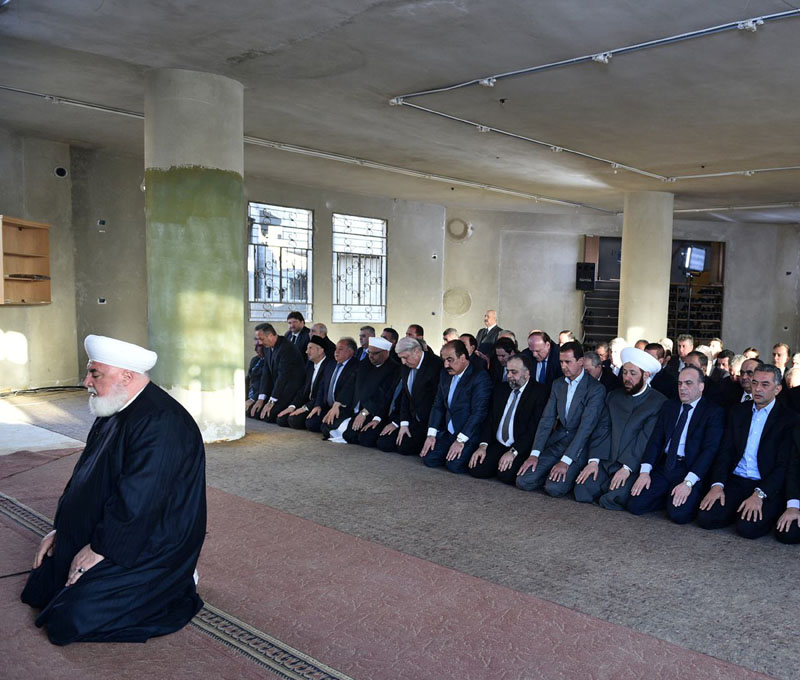Syria's president Bashar al-Assad (4th Right), prays at a mosque in a Damascus suburb of Daraya, Syria in this handout picture provided by SANA on September 12, 2016. Photo: Reuters