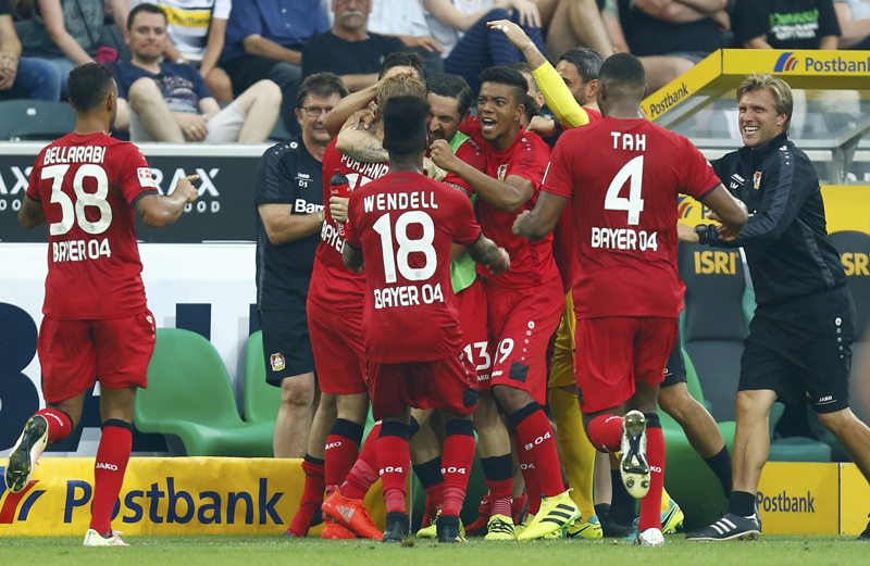 Bayer 04 Leverkusen's Joel Pohjanpalo celebrates with team mates after scoring a goal against Borussia Moenchengladbach. Photo: Reuters