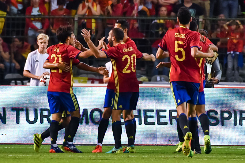 Spain's David Silva (L) celebrates with teammates after he scored against Belgium during a friendly soccer match at the King Baudouin stadium in Brussels on Thursday, September 1, 2016. Photo: AP