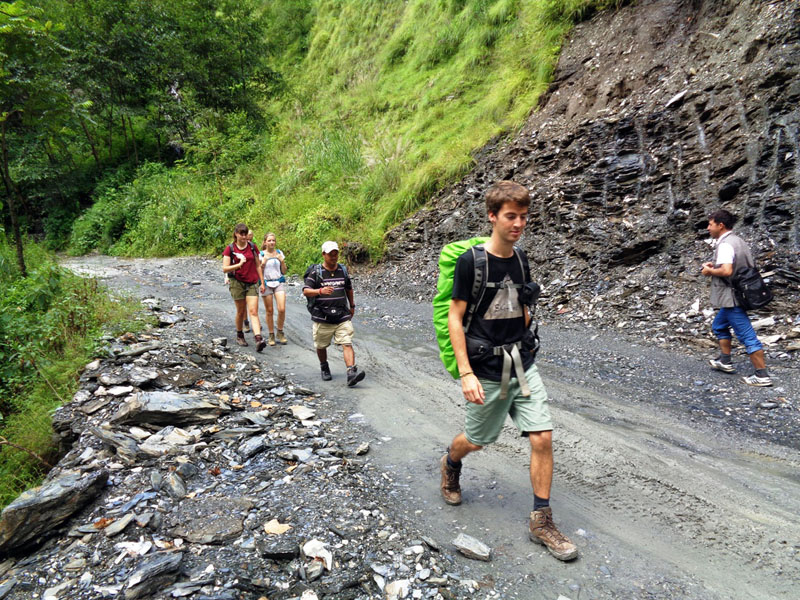 Tourists march their way to the destination, Mustang, after the landslides and the floods at several places obstruct the vehicular movement along the Beni-Jomsom road, in Myagdi district, on Monday, September 5, 2016. Photo: RSS