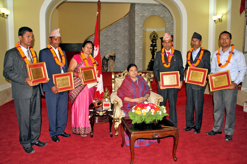 Teachers being honoured with the Best Teachers Award established by PP Foundation pose for a photo with President Bidya Devi Bhandari, in Kathmandu, on Monday, September 5, 2016. Photo: RSS