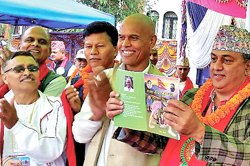 Minister for Forest and Soil Conservation Shankar Bhandari launching na book written by journalist Kedar Khadka (second from right) at a programme in Bhaktapur to declare it Nepalu0092s first ever yoga district, on Monday, September 26, 2016. Photo: THT