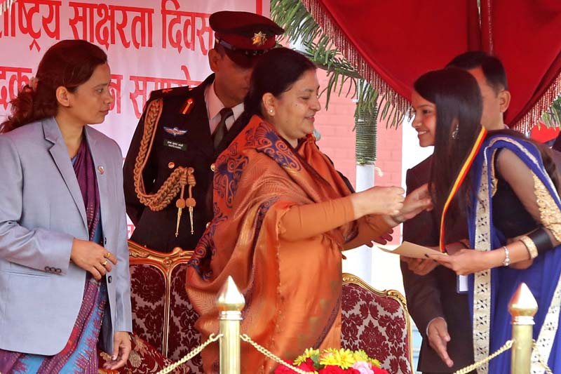 President Bidya Devi Bhandari confers the 'Nepal Bidya Bhushan' (A) on Chandika Pokharel on the occasion of the 37th National Education Day, at the Presidentu2019s Office in Maharajgunj, on Thursday, September 8, 2016. Photo: RSS
