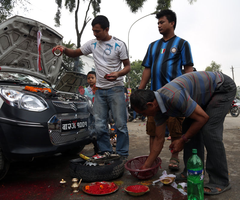 People worship their vehicles  on the occasion of Bishwokarma Pooja, a Hindu festival on Saturday, September 17, 2016. Photo: RSS