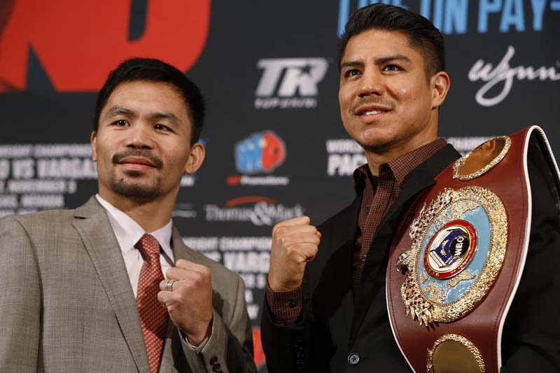 Manny Pacquiao (left) and Jessie Vargas pose during a news conference about their WBO welterweight title fight scheduled for November 5, in Beverly Hills, California, on Thursday, September 8, 2016. Photo: AP
