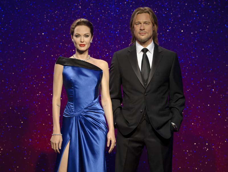 File- This 2013 photo released by Madame Tussauds shows wax figures resembling married actors Angelina Jolie (L) and Brad Pitt on display at a Madame Tussauds wax museum. Photo: AP