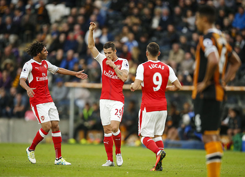 Arsenal's Granit Xhaka (centre), celebrates scoring his side's fourth goal during their English Premier League soccer match against Hull at the KCOM Stadium, Hull, England, on Saturday, September, 17, 2016. Photo: Danny Lawson/PA via AP
