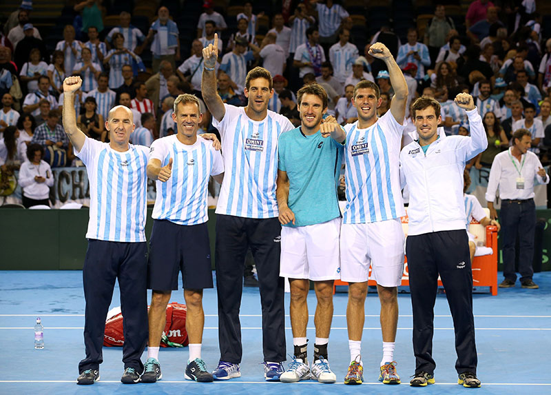 Argentina's Davis Cup team members celebrate victory over Great Britain during day three of the Davis Cup at the Emirates Arena in Glasgow, Scotland, on Sunday September 18, 2016. Photo: Jane Barlow / PA via AP
