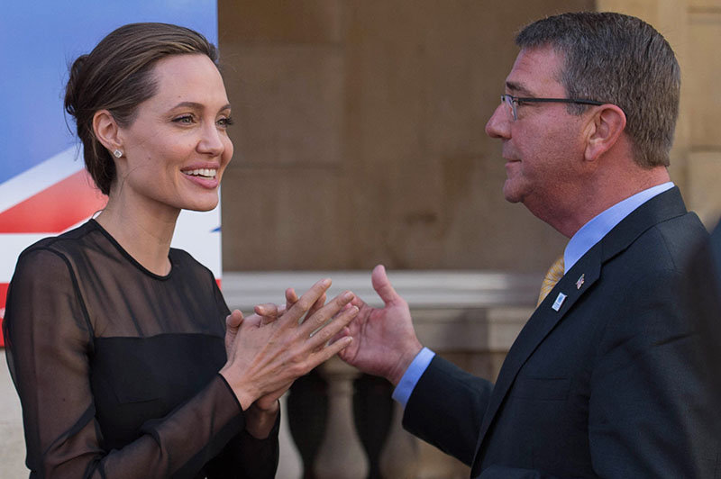 UN Special Envoy Angelina Jolie Pitt (left) speaks to US Defence Secretary Ash Carter, as she attends a UN Peacekeeping Defence Ministerial meeting, in London, on Thursday, September  8, 2016. Photo: Stefan Rousseau/PA via AP