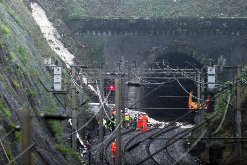 Workers attend the scene of a the landslip near Watford Junction station, England, which has caused a train to be derailed, on Friday, September 16, 2016. Photo: AP