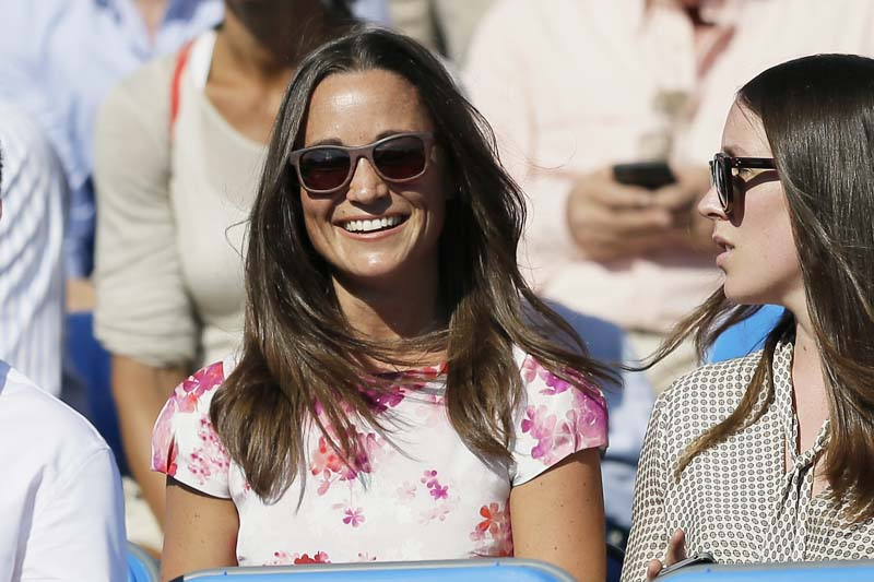 File- Pippa Middleton (L), the sister of Kate, the Duchess of Cambridge, watches the quarterfinal tennis match between Canada's Milos Raonic and France's Gilles Simon on the fifth day of the Queen's Championships in London, on Friday, June 19, 2015. Photo: AP