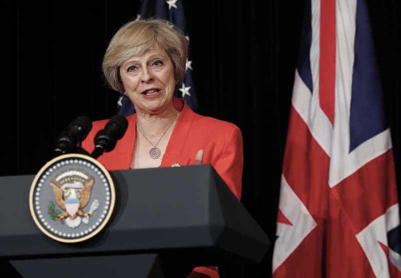 British Prime Minister Theresa May talks to media with US President Barack Obama after their bilateral meeting in Hangzhou in eastern China's Zhejiang province, on Sunday, September 4, 2016, alongside the G20. Photo: AP