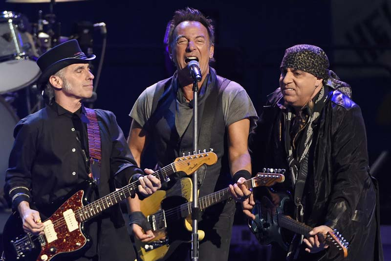 Bruce Springsteen (centre) performs with Nils Lofgren (left) and Steven Van Zandt of the E Street Band during their concert at the Los Angeles Sports Arena in Los Angeles on this March 15, 2016. Photo: AP/ File