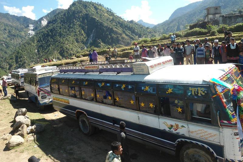 Passenger buses reach Bajura district headquarters, Martadi, after 21 years of beginning of the Sanphe-Martadi road construction, on Wednesday, September 28, 2016. Photo: Prakash Singh