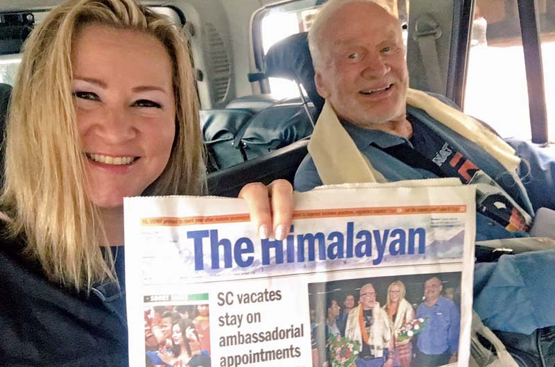 Buzz Aldrin (right), former NASA astronaut and one of the first two humans to set foot on the Moon, poses for a photograph with his manager Christina Korp holding a copy of The Himalayan Times, in Kathmandu, on Monday, September 5, 2016. Photo Courtesy: Buzz Aldrin/ Twitter