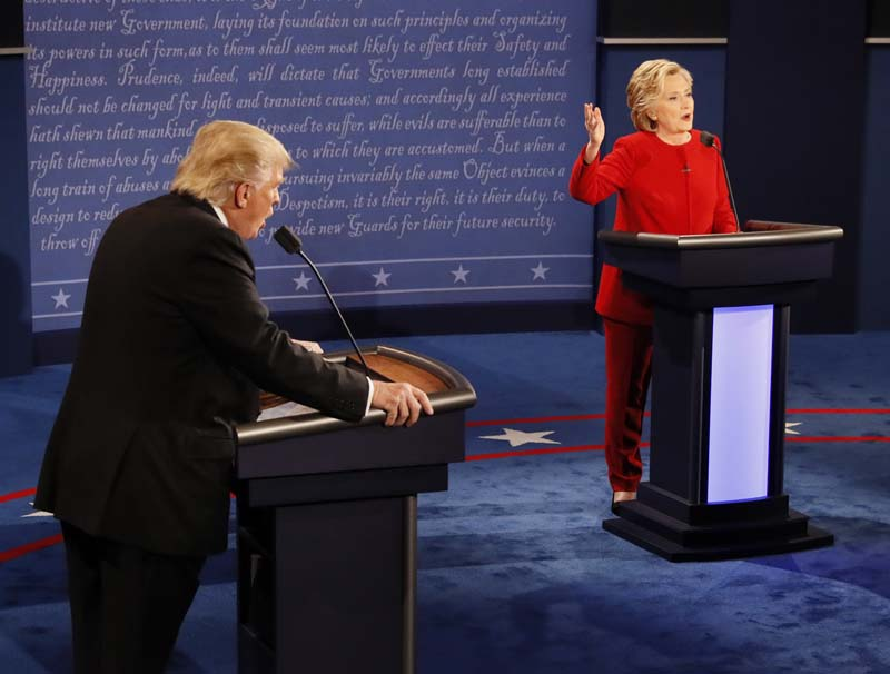 Republican presidential nominee Donald Trump and Democratic presidential nominee Hillary Clinton speak at the same time during the presidential debate at Hofstra University in Hempstead, New York, on Monday, September 26, 2016. Photo: AP