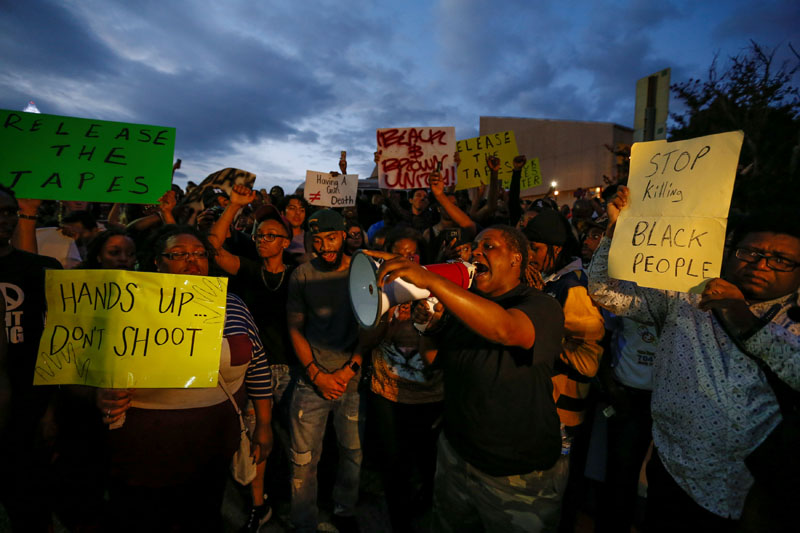 Lameka Jackson shouts to fellow activists in uptown Charlotte, NC to protest the police shooting of Keith Scott, in Charlotte, North Carolina, US, on September 21, 2016. Photo: Reuters
