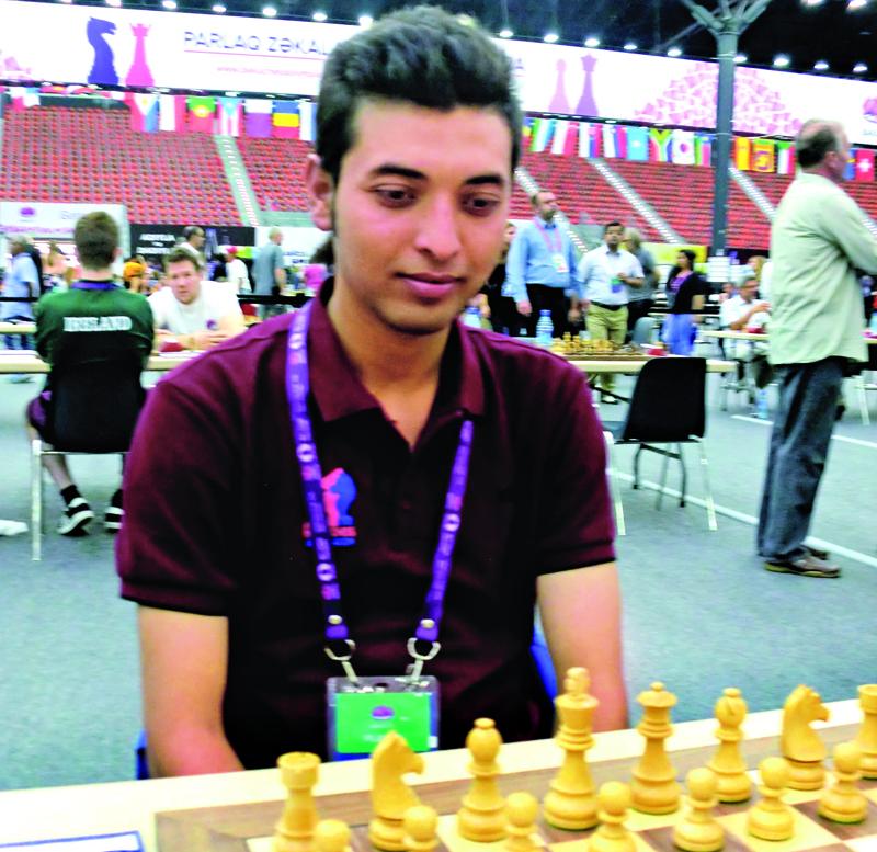 Nepal's Kshitiz Bhandari ponders his move during the 42nd Chess Olympiad in Baku on Sunday, September 11, 2016.
