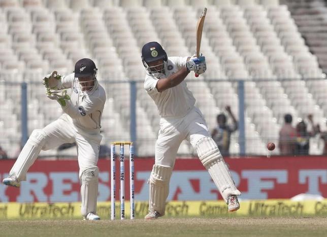Cricket - India v New Zealand - Second Test cricket match - Eden Gardens, Kolkata - 30/09/2016. India's Cheteshwar Pujara (R) plays a shot past New Zealand's wicketkeeper Bradley-John Watling. REUTERS/Rupak De Chowdhuri