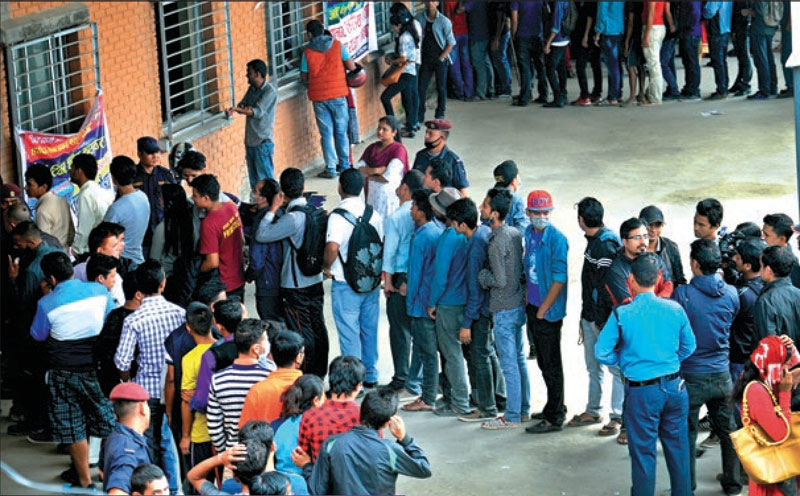 People queuing to book bus tickets to travel to their home districts for Dashain festivities, in New Bus Park, Kathmandu, on Friday, September 23, 2016. THT