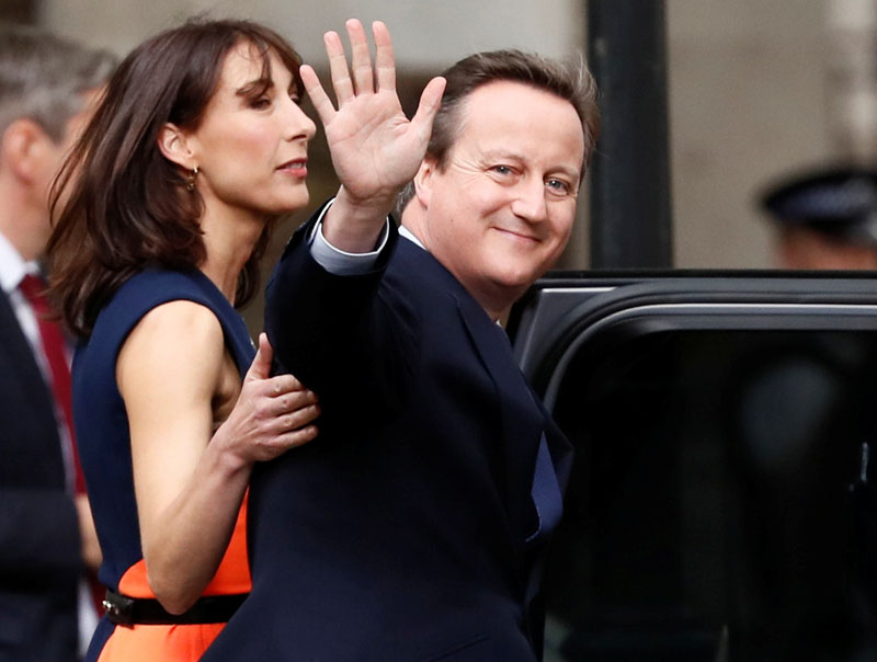 Britain's outgoing Prime Minister, David Cameron with his wife Samantha, waves in front of number 10 Downing Street, on his last day in office as Prime Minister, in central London, Britain, on July 13, 2016. Photo: Reuters
