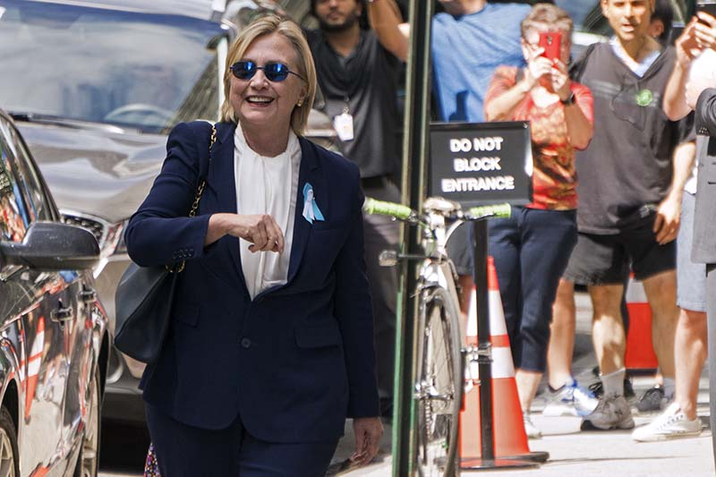 Democratic presidential candidate Hillary Clinton walks from from her daughter's apartment building, in New York, on Sunday, September 11, 2016. Photo: AP
