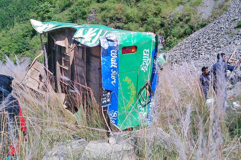 Wreckage of the bus that skidded off the road at Marpak-5 in Dhading district, on Tuesday, September 27, 2016. Photo: Keshav Adhikari