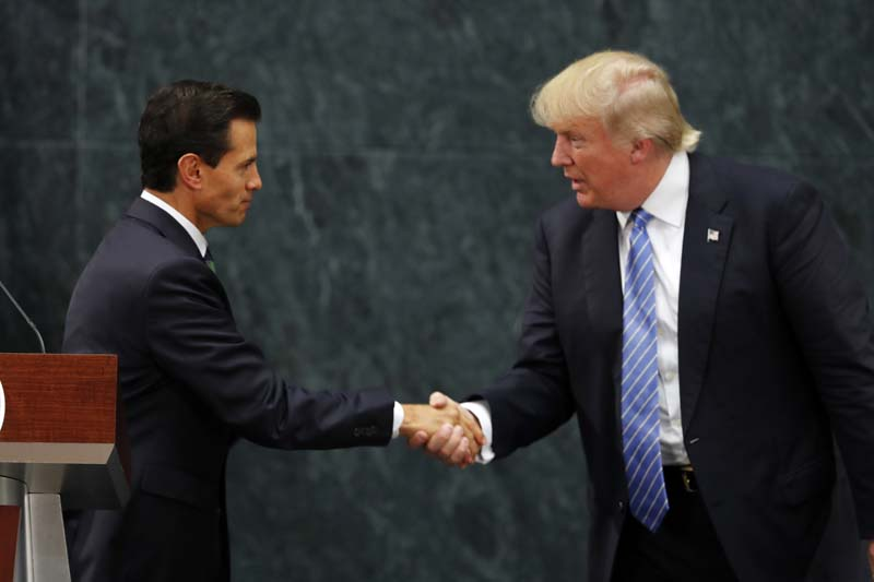 File- Mexico President Enrique Pena Nieto and Republican presidential nominee Donald Trump shake hands after a joint statement at Los Pinos, the presidential official residence, in Mexico City, on Wednesday, August 31, 2016. Photo: AP