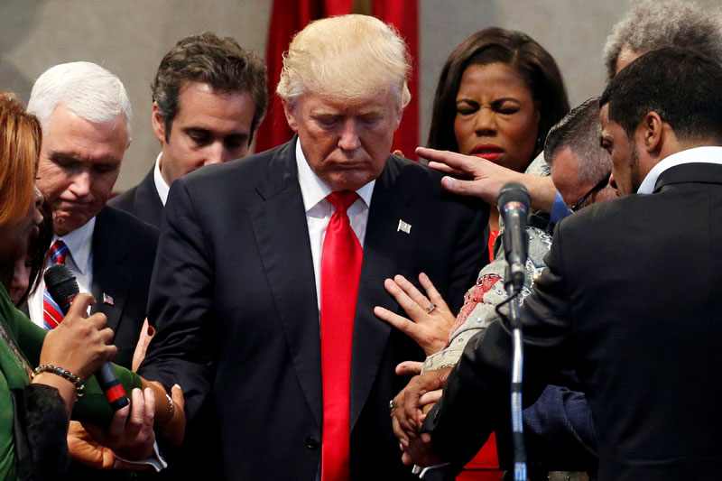 Members of the clergy lay hands and pray over Republican presidential nominee Donald Trump at the New Spirit Revival Center in Cleveland Heights, Ohio, US, on September 21, 2016. Photo: Reuters