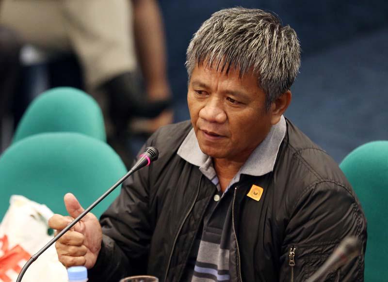 Former Filipino militiaman Edgar Matobato gestures as he testifies before the Philippine Senate in Pasay, south of Manila, Philippines on Thursday, September 15, 2016. Photo: AP