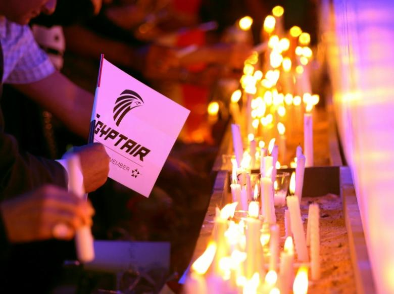 People light candles during a candlelight vigil for the victims of EgyptAir flight 804, at the Cairo Opera house in Cairo, Egypt May 26, 2016. REUTERS/Mohamed Abd El Ghany