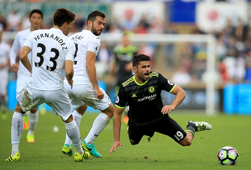 Chelsea's Diego Costa (right) falls to the ground during the English Premier League soccer match between Swansea City and Chelsea at the Liberty Stadium, Swansea, Wales, Sunday, Sept. 11, 2016. Photo: Mike Egerton/PA via AP