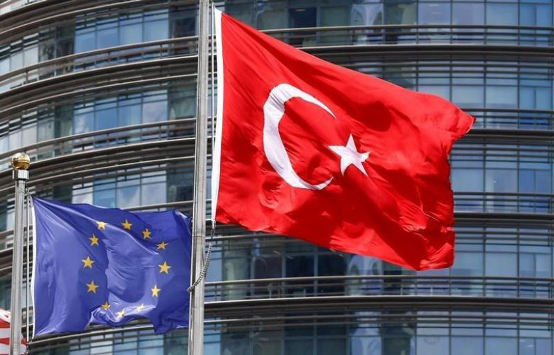 European Union (left) and Turkish flags fly outside a hotel in Istanbul, Turkey, on May 4, 2016. Reuters