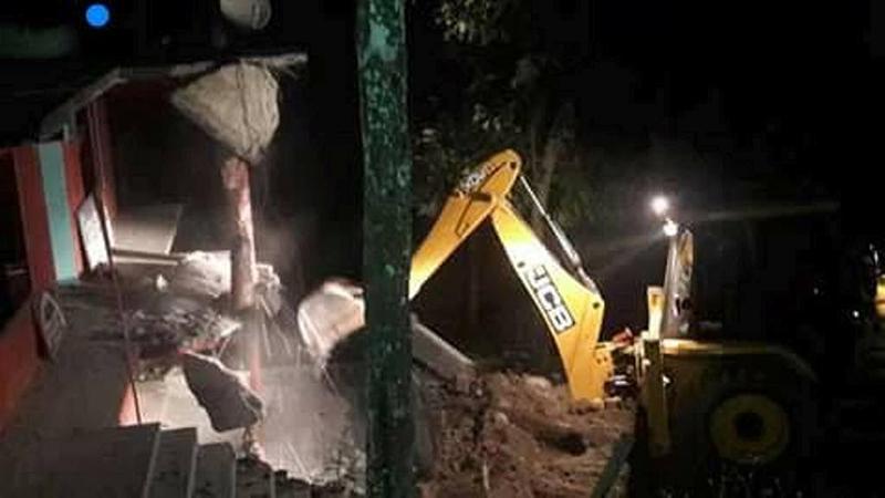 An excavator demolishes the building of Radio Dhading 106 MHz on Friday, September 23, 2016. Photo: Keshav Adhikari