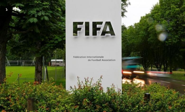 Cars drive past a logo in front of FIFA's headquarters in Zurich, Switzerland June 8, 2016. REUTERS/Arnd Wiegmann/File Photo