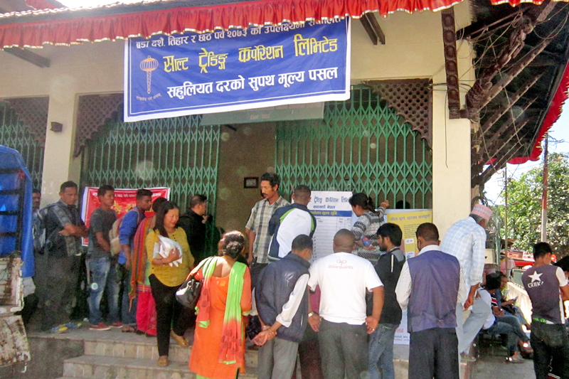 People throng a fair price shop run by the Salt Trading Corporation Limited, in coordination with the Ministry of Supplies, in the run-up to the great festivals, in Jawalakhel of Lalitpur district, on Sunday, September 18, 2016. Photo: RSS