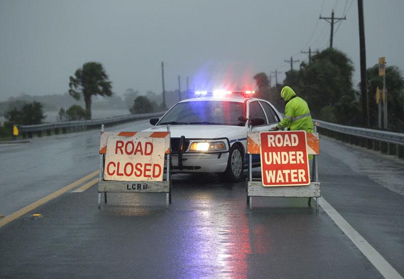Police block the road entering Cedar Key, Fla., as Hurricane Hermine nears the Florida coast, on Thursday, September 1, 2016. Photo: AP