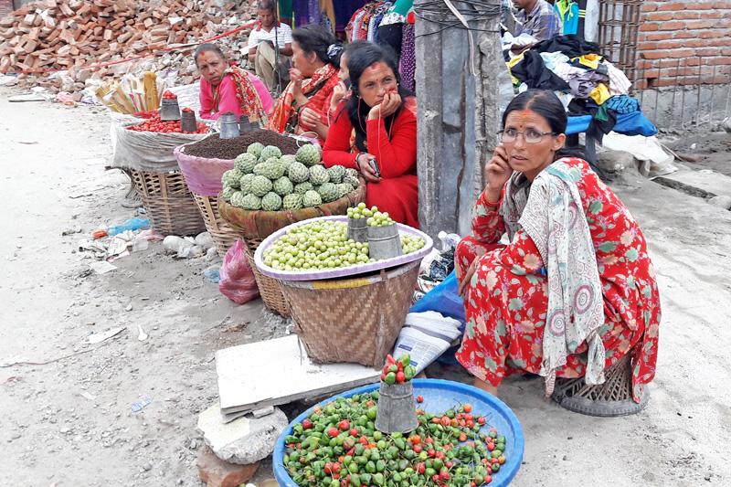 Fruit vendors waiting for customers in-front of Bisal Bazaar, in Kathmandu, on Wednesday, September 14, 2016. Photo: RSS