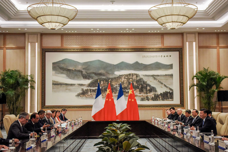 Chinese President Xi Jinping (Right) and French President Francois Hollande (2nd Left) during their meeting at the West Lake State House on the sidelines of the G20 Summit, in Hangzhou, Zhejiang province, China, on September 5, 2016.  Photo: Reuters