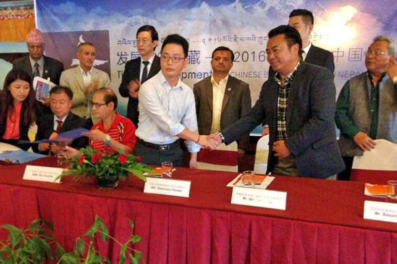 Nepal Tianli Publication and Culture Company Managing Director Ge Weimin shakes hands with Qui Dongfang of the Tibet Peopleu2019s Publishing House during the Chinese Book Fair 2016, at the Malla Hotel, in Kathmandu, on Saturday, September 24, 2016. Photo Courtesy: Nepal Tianli Publication and Culture Company