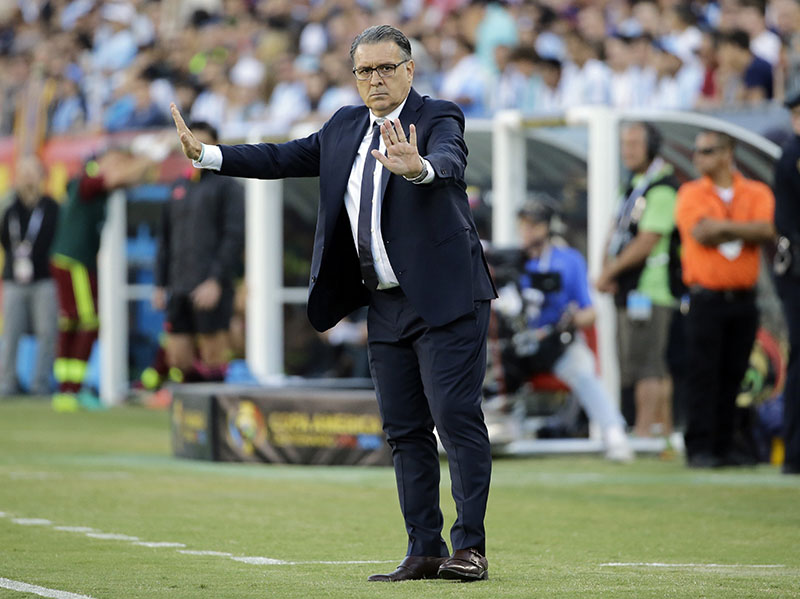 FILE - Argentina's coach Gerardo Martino instructs his team from the sideline during a Copa America Centenario quarterfinal soccer match with Venezuela in Foxborough, Massachusetts, on June 18, 2016. Photo: AP