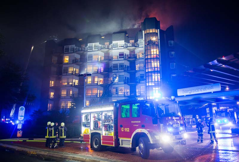 Fire trucks stand in front of the Bergmannsheil hospital after a fire broke out, in Bochum, western Germany, on Friday, September 30, 2016. Photo: AP