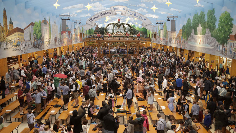 People enter a tent and wait for the opening of the 183rd Oktoberfest beer festival in Munich, southern Germany on Saturday, September 16, 2016. Photo: AP