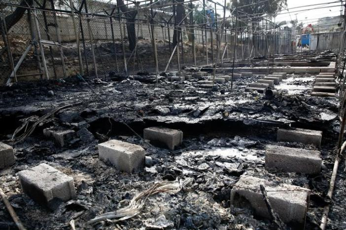 The remains of a burned tent at the Moria migrant camp, after a fire that ripped through tents and destroyed containers during violence among residents, on the island of Lesbos, Greece, September 20, 2016. REUTERS/Giorgos Moutafis