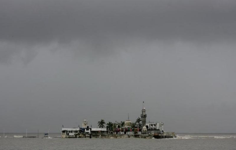 File - Monsoon clouds gather over Haji Ali mosque during heavy rains in Mumbai June 7, 2008. Photo: Reuters