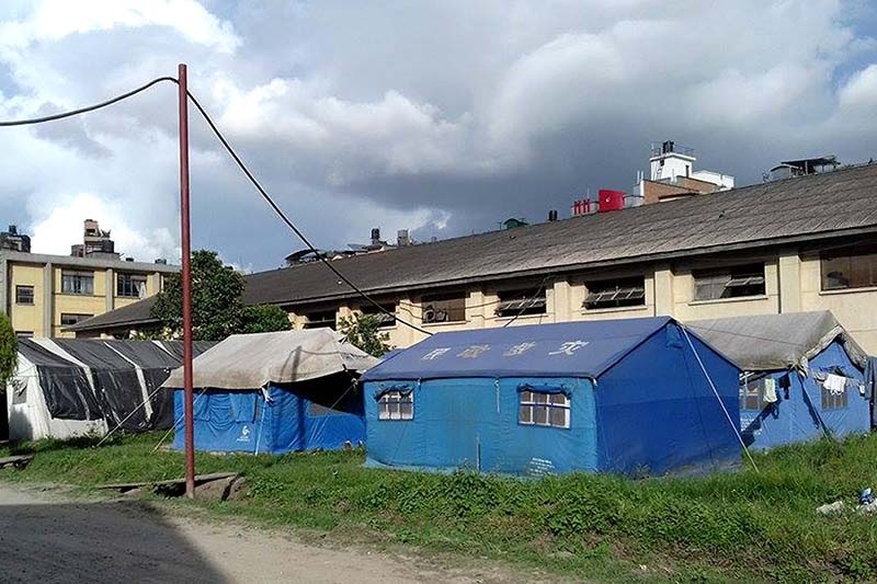 Offices of the Metropolitan Police Range Kathmandu and the Metropolitan Police Crime Division function under the tents at the premises of the National Trading Limited, in Teku, on Thursday, September 15, 2016. The Hanuman Dhoka-based offices had shifted to Teku after the 2015 earthquake. Photo: RSS