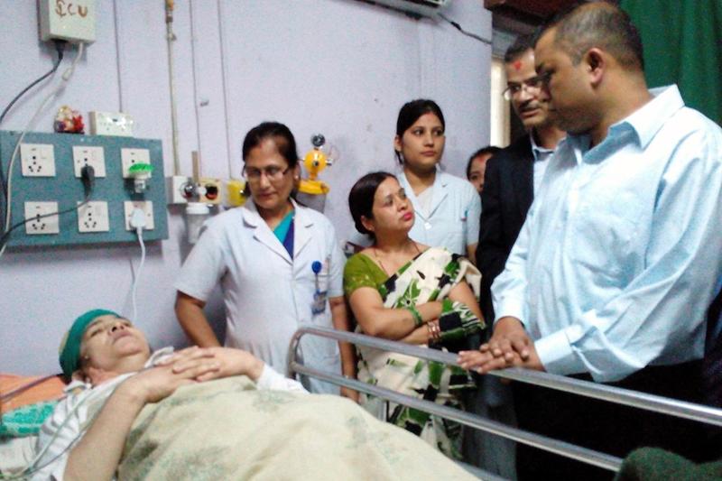 Health Minister Gagan Thapa meets Ganga Maya Adhikari, at the Bir Hospital, in Kathmandu, on Saturday, September 1, 2016. Photo: RSS