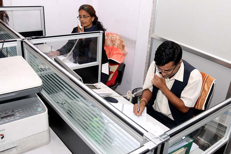 Staff of the Hello Sarkar programme under the PMu2019s Office receive complaints from the common public over telephones, in Kathmandu, on Sunday, 25 September 2016. Photo: RSS