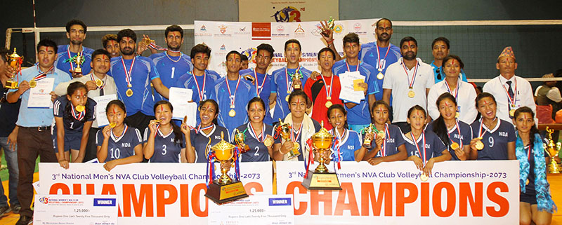 Players and officials of Help Nepal Sports Club (menu2019s champions) and New Diamond Academy (womenu2019s winners) pose for a group photo after the third NVA National Club Volleyball Championship at the National Sports Council covered hall in Kathmandu, on Monday, September 19, 2016. Photo: Udipt Singh Chhetry/THT