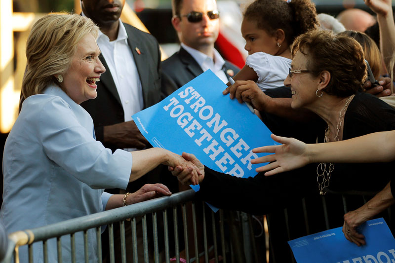 US Democratic presidential nominee Hillary Clinton greets audience members during a campaign stop at the 49th Annual Salute to Labor in Hampton, Illinois, US, on September 5, 2016. Photo: Reuters